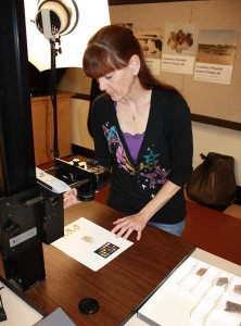 Holly Pritchett photographing sherds on the copystand.